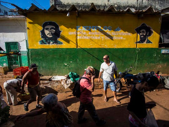 People do their shopping at a food market in Havana,