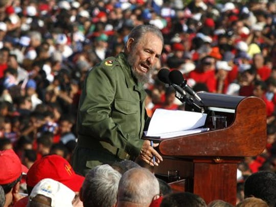 FILE - In this  May 1, 2006 file photo, Cuba's leader Fidel Castro speaks on International Workers Day in Revolution Plaza in Havana, Cuba. Former President Fidel Castro, who led a rebel army to improbable victory in Cuba, embraced Soviet-style communism and defied the power of 10 U.S. presidents during his half century rule, has died at age 90. The bearded revolutionary, who survived a crippling U.S. trade embargo as well as dozens, possibly hundreds, of assassination plots, died eight years after ill health forced him to formally hand power over to his younger brother Raul, who announced his death late Friday, Nov. 25, 2016, on state television.