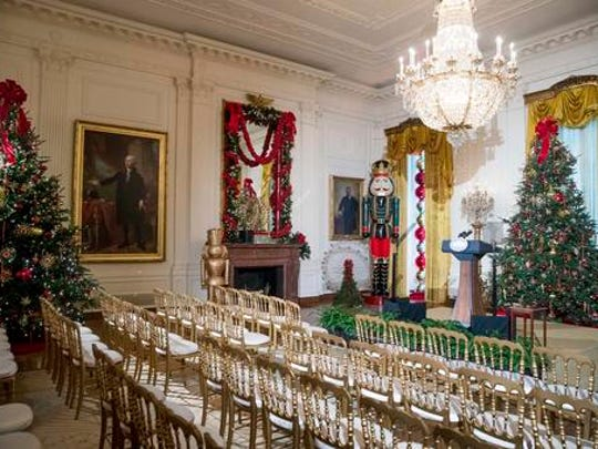 The East Room is decorated at the White House during a preview of the 2016 holiday decor, Tuesday, Nov. 29, 2016, in Washington.