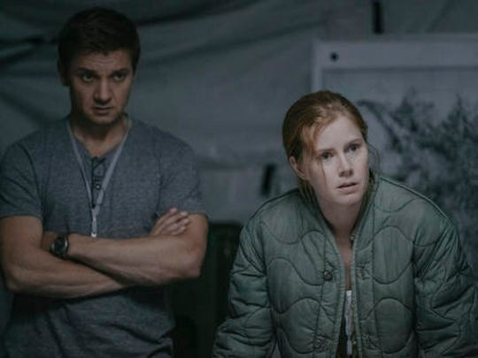 "This image released by Paramount Pictures shows Jeremy Renner, left, and Amy Adams in a scene from ""Arrival."" Adams won best actress by the National Board of Review for her role in the cerebral sci-fi thriller."