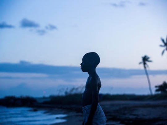 "This image released by A24 Films shows Alex Hibbert in a scene from the film, ""Moonlight."" The National Board of Review awarded best director to Barry Jenkins, and best supporting actress for Naomie Harris for their work on the film."