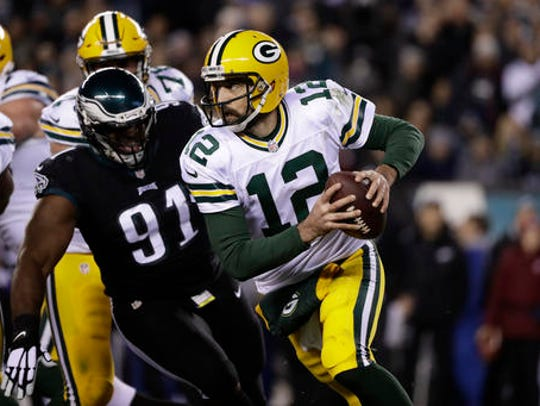 Eagles defensive tackle Fletcher Cox gives chase as Packers quarterback Aaron Rodgers tries to escape during a 2016 game.