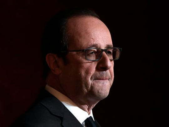 French President Francois Hollande delivers a speech after awarding the Legion of Honour (Legion d'Honneur) and the National Order of Merit (Ordre National du Merite) to Olympic and Paralympic athletes at the Elysee Presidential Palace in Paris, France, Thursday, Dec. 1, 2016. French President Hollande says he's not running in 2017 because he knows he might not have enough support.