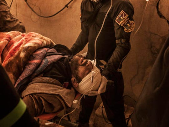 A wounded Iraqi man is treated by Iraqi army doctors