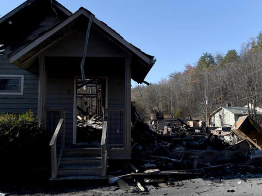 Damage and destroyed buildings are seen in Gatlinburg, Tenn., Friday, Dec. 2, 2016. Residents on Friday, were getting their first look at what remains of their homes and businesses in Gatlinburg, after a wildfire tore through the resort community on Monday, Nov. 28.