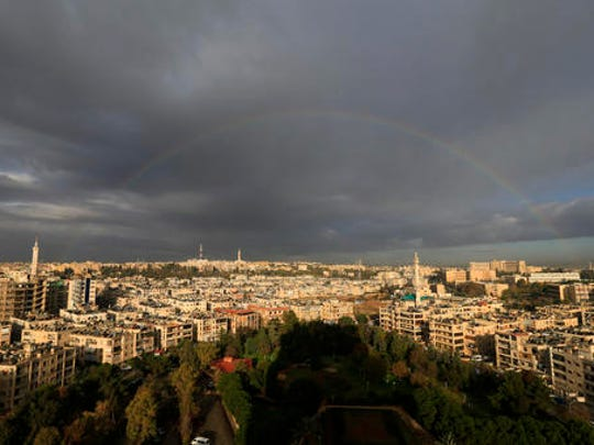 A rainbow appears after a heavy rain over the Aleppo,
