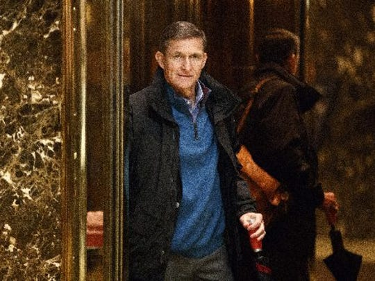 Retired Gen. Michael Flynn, National Security Adviser for President-elect Donald Trump, gets on an elevator after arriving at Trump Tower, Tuesday, Nov. 29, 2016, in New York.