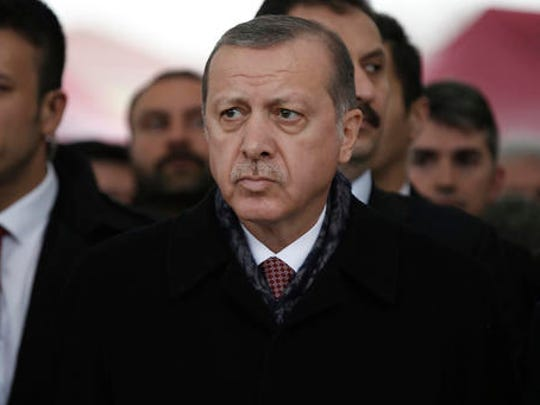 Turkey's President Recep Tayyip Erdogan attends the funeral prayers for police officer Hasim Usta, who was killed with dozens of others late Saturday outside the Besiktas football club stadium Vodafone Arena, in Istanbul, Monday, Dec. 12, 2016. Turkey's police rounded up more than 100 members of a Kurdish political party on Monday as the country mourned the dozens killed in a bombing attack near an Istanbul soccer stadium. Turkish authorities have banned distribution of images relating to the Istanbul explosions within Turkey.
