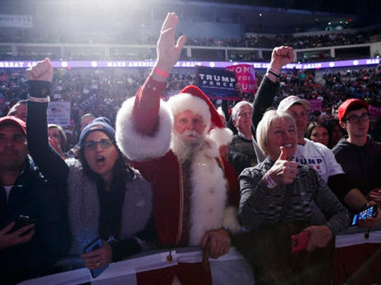 Supporters of President-elect Donald Trump cheer during
