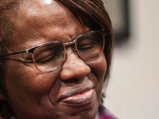 "Felicia Sanders, who watched her son Tywanza Sanders die at the hands of Dylann Roof, smiles while speaking to media after Roof was found guilty of murdering nine parishioners at Emanuel AME Church in Charleston in a hate crime Friday, Dec. 15, 2016, in Charleston S.C. ""I wear a smile now because the nine victims wore beautiful smiles in photos before they were killed,"" Sanders said."