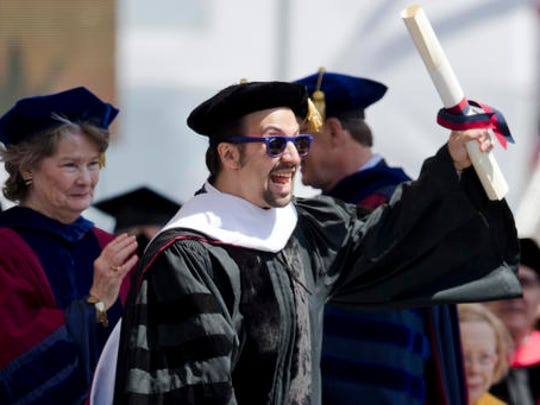 """FILE - In this May 16, 2016 file photo Lin-Manuel Miranda, creator of the Broadway musical """"Hamilton,"""" reacts after receiving an honorary degree during the University of Pennsylvania commencement ceremony in Philadelphia.  Miranda, who was everywhere in popular culture this year, was named The Associated Press Entertainer of the Year, voted by members of the news cooperative."""