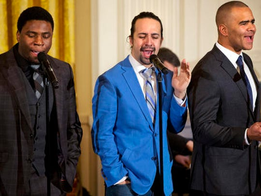 """FILE - In this March 14, 2016 file photo shows actors, from left, Okieriete Onaodowan, Lin-Manuel Miranda and Christopher Jackson perform the song """"Alexander Hamilton"""" from the Broadway play """"Hamilton"""" in the East Room of the White House in Washington. Miranda, who was everywhere in popular culture this year, was named The Associated Press Entertainer of the Year, voted by members of the news cooperative."""