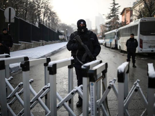A Turkish police officer secures the road leading to the Russian embassy in Ankara, Turkey, Wednesday, Dec, 21, 2016. Russian Ambassador to Turkey, Andrei Karlov, was assassinated Monday by a police officer during the opening of a photo exhibition.