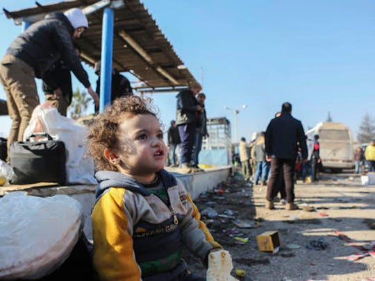 A Syrian child evacuated from the embattled Syrian city of Aleppo during the ceasefire arrives at a refugee camp in Rashidin, near Idlib, Syria, Tuesday, Dec. 20, 2016. Russian Foreign Minister Sergey Lavrov said on Tuesday that Russia, Iran and Turkey are ready to act as guarantors in a peace deal between the Syrian government and the opposition. He spoke on Tuesday after a meeting of the three countries' foreign ministers in Moscow.