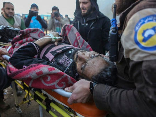 An injured Syrian arrives at a refugee camp in Rashidin, near Idlib, Syria, after was evacuated from the embattled Syrian city of Aleppo during the ceasefire, Tuesday, Dec. 20, 2016. Russian Foreign Minister Sergey Lavrov said on Tuesday that Russia, Iran and Turkey are ready to act as guarantors in a peace deal between the Syrian government and the opposition. He spoke on Tuesday after a meeting of the three countries' foreign ministers in Moscow.