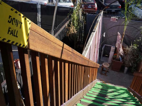 This Dec. 19, 2016 photo shows an exterior stairway of an underground music club known as known as Purple 33 in a Playa Vista neighborhood of Los Angeles. About a week after 36 people died in a fire at an underground music party in Oakland, inspectors acting on a complaint discovered a makeshift nightclub and unpermitted living quarters concealed in a warehouse near Los Angeles International Airport. After the deadly fire, officials in LA, Baltimore and other cities announced plans to aggressively pursue illegally converted warehouses and other jerry-rigged living spaces.