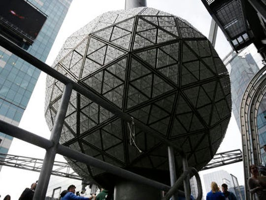 The New Year's Eve ball rests at the top of a building