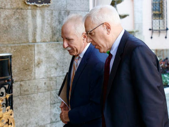 Johns Hopkins Medicine CEO Dr. Paul Rothman, left, and Carlyle Group co-founder and co-CEO David Rubenstein arrive at Mar-a-Lago for meetings with President-elect Donald Trump and his transition team, Wednesday, Dec. 28, 2016, in Palm Beach, Fla.