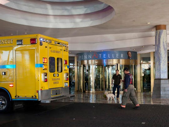 A Clark County firefighter walks past a guest standing outside the Ipanema Tower at the Rio Hotel & Casino after reports of smoke coming from the 21st floor of the Masquerade Tower led to guests being evacuated Thursday, Dec. 29, 2016. The Rio casino in Las Vegas scrambled to find alternate lodging for guests Thursday after a power outage led to the evacuation of 900 rooms just before the busy New Year's Eve weekend, officials said. Nobody was injured, but emergency responders helped some guests with disabilities get to the bottom of the tower.