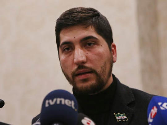 Osama Abu Zeid of the main moderate Syrian opposition group Free Syrian Army, talks about the five-point cease-fire agreement for Syria, during a news conference, in Ankara, Turkey, Thursday, Dec. 29, 2016. Abu Zeid said that his group, is one of the 13 armed opposition factions, that had agreed to abide by the nationwide cease-fire agreement that will go into effect at midnight Thursday. The truce will be followed by peace talks in Kazakhstan to find a solution for Syria's crisis, Abu Zeid said.