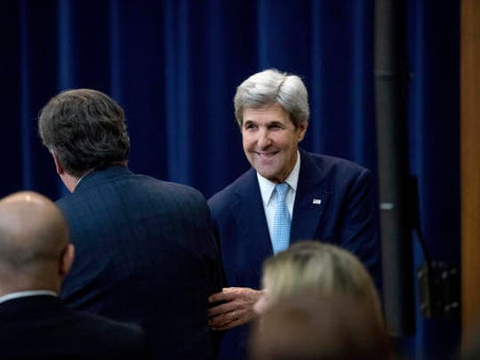 Secretary of State John Kerry greets a member of the audience after speaking at the State Department in Washington, Wednesday, Dec. 28, 2016. Stepping into a raging diplomatic argument, Kerry staunchly defended the Obama administration's decision to allow the U.N. Security Council to declare Israeli settlements illegal and warned that Israel's very future as a democracy is at stake.