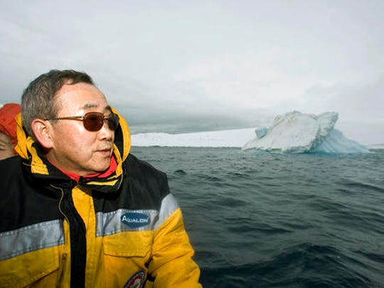 In this Nov. 9, 2007 photo provided by the United Nations, U.N. Secretary-General Ban Ki-moon looks out over the waters off King George Island, Antarctica. Passionate about the environment, Ban worked to raise climate change close to the top of the global agenda.