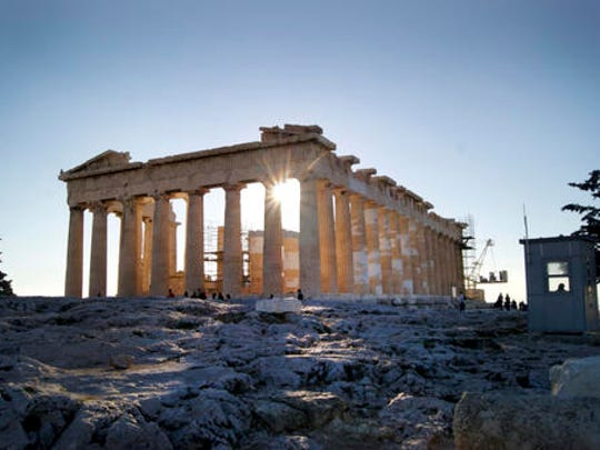 In this Dec. 11, 2016 photo, the Parthenon is shown, a temple dedicated to the goddess Athena. For travelers with more than beaches on their minds, there's plenty of upside to a brief winter visit to Athens that avoids the crowds and heat of summer.