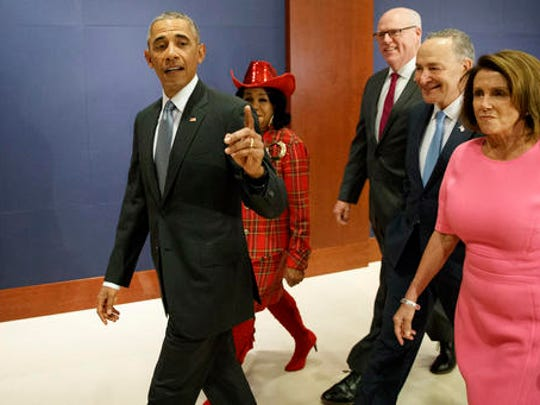 President Barack Obama, joined by, from second from left, Rep. Frederica Wilson, D-Fla., Rep. Joseph Crowley, D-N.Y., Senate Minority Leader Charles Schumer of N.Y., and House Minority Leader Nancy Pelosi of Calif. arrives on Capitol Hill in Washington, Wednesday, Jan. 4, 2017, to meet with members of Congress to discuss his signature healthcare law.