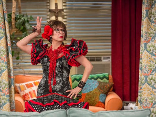 """This image released by Netflix shows Rita Moreno in a scene from """"One Day At A Time."""" The series, a remake of the 1970's-80's Norman Lear TV series, centers on a Cuban-American family. It debuts on Netflix on Sunday."""