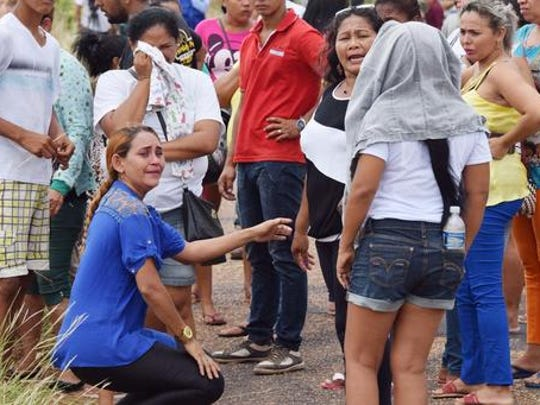 BRAZIL OUT - Relatives wait for information on the welfare of inmates, outside the Agricultural Penitentiary of Monte Cristo, after  dozens of prisoners were killed, in Boa Vista, Roraima state, Brazil, Friday, Jan. 6, 2017. Scores of inmates were slain, some with their hearts and intestines ripped out, during a prison killing spree led by Brazil's largest gang, authorities said.