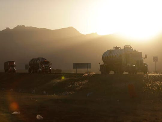 Trucks drive on a highway through the Ford construction site, one day after the U.S. auto company cancelled plans to build its plant for the Ford Focus in Villa de Reyes, outside San Luis Potosi, Mexico, Wednesday, Jan. 4, 2017. Ford cited supply and demand rather than politics, according to San Luis Potosi State Economic Development Secretary Gustavo Puente Orozco, and Ford CEO Mark Fields said they will produce the Ford Focus at an existing plant in Hermosillo, Mexico.