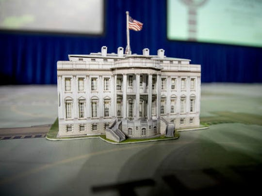 FILE - In this Dec. 14, 2016, file photo, a model of the White House is displayed on a giant planning map during a media tour highlighting inaugural preparations being made by the Joint Task Force-National Capital Region for military and civilian planners at the DC Armory in Washington. It's typically an unquestioned honor to participate in the inauguration of an American president. This time, though, it's different. The sharp divisions over Donald Trump's election have politicians, celebrities and even high school students debating whether taking part in the inauguration is a political act that demonstrates support for the new president and his agenda or a nonpartisan tribute to democratic traditions and the peaceful transfer of power.