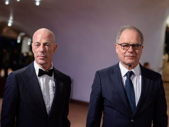The architects Jacques Herzog, left, and Pierre de Meuron arrive for the inauguration of the Elbphilharmonie concert hall in Hamburg, Germany, Wednesday, Jan. 11, 2017. The concert hall will be inaugurated with a concert and an official ceremony.
