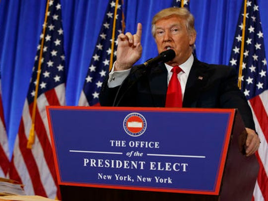 President-elect Donald Trump speaks during a news conference in the lobby of Trump Tower in New York, Wednesday, Jan. 11, 2017.