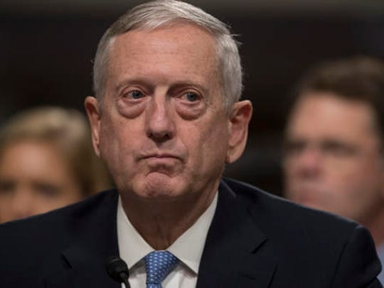 FILE - In this Jan. 12, 2017 file photo, Defense Secretary-designate James Mattis listens on Capitol Hill in Washington while testifying at his confirmation hearing before the Senate Armed Services Committee. Some of President-elect Donald Trump's most important Cabinet choices are at odds with him on matters that were dear to his heart as a campaigner and central to his promises to supporters. For the Pentagon, the CIA, the State Department and more, Trump has picked people who publicly disagree with him on some cornerstones of his agenda In confirmation hearings.