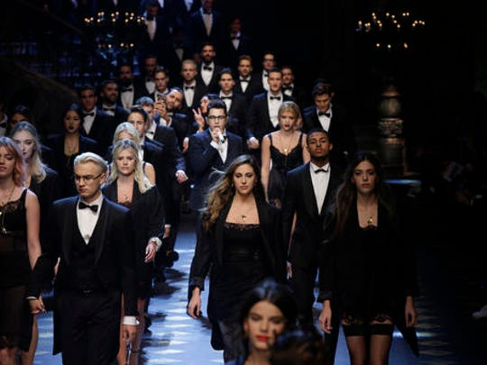 Models wear creations for Dolce & Gabbana men's Fall-Winter 2017-2018 collection, part of the Milan Fashion Week, unveiled in Milan, Italy, Saturday, Jan. 14, 2017.