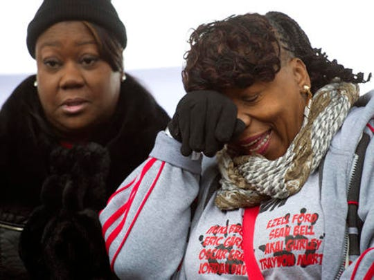 Sabrina Fulton, mother of Trayvon Martin, left, and Gwen Carr, mother of Eric Garner, stand onstage after speaking during a civil rights advocates rally to honor the Rev. Martin Luther King, Jr. in Washington, Saturday, Jan. 14, 2017.