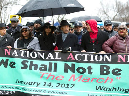 """Rev. Al Sharpton, center, and civil rights advocates march to honor the Rev. Martin Luther King, Jr. in Washington, Saturday, Jan. 14, 2017. The National Action Network, the group founded by the Rev. Al Sharpton, is sponsoring Saturday's """"We Shall Not Be Moved"""" march and rally ahead of Monday's Martin Luther King Jr. Day holiday."""