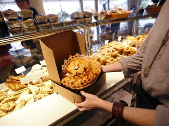 A King cake is boxed for sale in La Boulangerie bakery