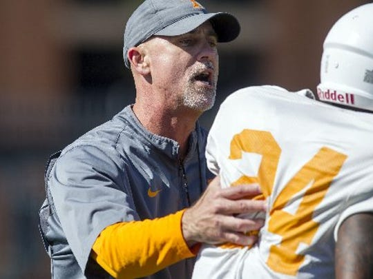 Tennessee defensive backs coach Willie Martinez talks with defensive back Darrell Miller  during practice on April 5, 2016.