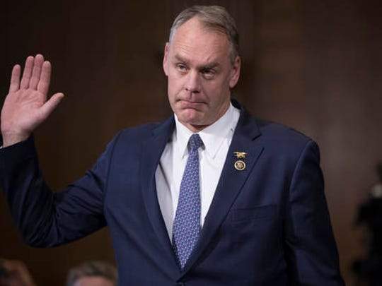 Interior Secretary-designate, Rep. Ryan Zinke, R-Mont., is sworn in on Capitol Hill in Washington, Tuesday, Jan. 17, 2017, prior to testifying at his confirmation hearing before the Senate Energy and Natural Resources Committee. Zinke, 55, a former Navy SEAL who just won his second term in Congress, was an early supporter of President-elect Donald Trump and, like his prospective boss, has expressed skepticism about the urgency of climate change.