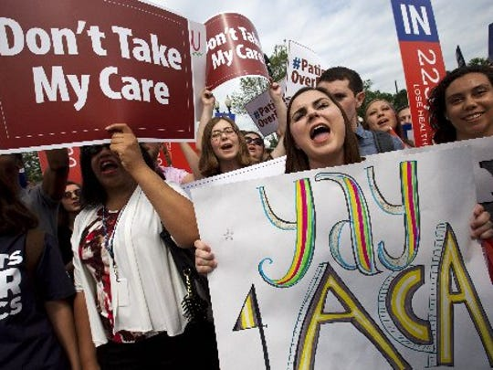"Jessica Ellis, right, holds a sign that says ""yay 4 ACA, "" as she and other supporters of the Affordable Care Act react with cheers as the opinion for health care is reported outside of the Supreme Court in Washington, Thursday June 25, 2015, in Washington."