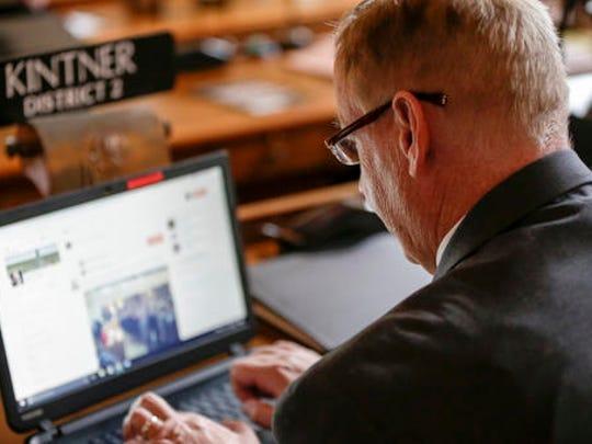 In this Jan. 4, 2017 photo, Neb. state Sen. Bill Kintner of Papillion works on his laptop in the legislative Chamber on the first day of the 2017 legislative session, in Lincoln, Neb. Sen. Kintner could face expulsion from the Legislature for retweeting a talk show host's joke implying that Women's March demonstrators are too unattractive to sexually assault. Kintner's fellow lawmakers railed against him Tuesday in response to public outrage over his online posting, the latest in a long history of inflammatory statements. (AP Photo/Nati Harnik)
