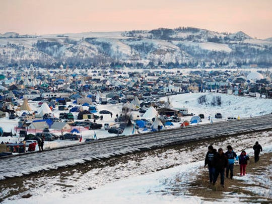 FILE - This Dec. 3, 2016, file photo shows the Oceti Sakowin camp where people have gathered to protest the Dakota Access oil pipeline near Cannon Ball, N.D. The first seasonal flood outlook from the National Weather Service indicates minor spring flooding is almost certain in the area of southern North Dakota where pipeline opponents are camping. The Friday, Jan. 27, 2017, outlook says there's little chance of major flooding but that parts of the camp area could be under water.