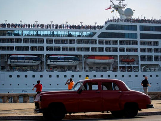 FILE - This May 2, 2016, file photo, shows the Adonia cruise ship arriving in Havana, Cuba, from Miami. The Adonia, operated by Carnival Corporation's Fathom brand, is scheduled to continue cruises to Cuba every other week through the last week in May. Havana is also on the itinerary for sailings from Florida in April and May aboard Royal Caribbean's Empress of the Seas ship and in May on Norwegian Cruise Line's Norwegian Sky. Long-term prospects for cruises and other forms of travel from the U.S. to Cuba remain uncertain under the new administration of President Donald Trump.