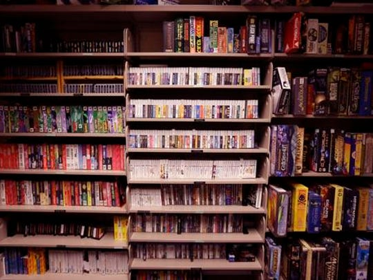 "In this May 20, 2016, video games are shelved at the Computer and Video Game Archive at the Duderstadt Center at the University of Michigan in Ann Arbor, Mich. The university's archive features over 7,000 titles - everything from time-honored favorites such as ""Pac-Man"" and ""Frogger"" to newer fare, including ""Call of Duty"" and ""Halo"" - on dozens of gaming systems. And unlike some other video game archives out there, students and members of the public alike are permitted to visit and play any game available, whether for research or just to relax."