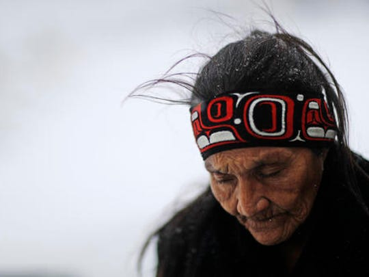 "FILE- Nov. 29, 2016, file photo, Grandma Redfeather of the Sioux Native American tribe walks in the snow to get water at the Oceti Sakowin camp where people have gathered to protest the Dakota Access oil pipeline in Cannon Ball, N.D. ""It's for my people to live and so that the next seven generations can live also,"" said Redfeather of why she came to the camp. ""I think about my grandchildren and what it will be like for them."" North Dakota Sen. John Hoeven said Tuesday, Jan. 31, 2017, that the Acting Secretary of the Army has directed the Army Corps of Engineers to proceed with an easement necessary to complete the Dakota Access pipeline."