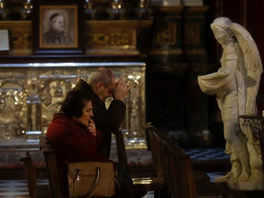Faithful pray in St. John Cathedral in downtown Valletta, Malta, Thursday, Feb. 2, 2017. After a quarter-century as Malta's governing party, the conservative Nationalist Party scrambled to line up a transgender young man as a candidate for next year's Parliamentary elections in hopes of reversing a stinging, landslide 2013 loss to its socialist archrivals who came to power with an agenda heavy on LGBT rights.