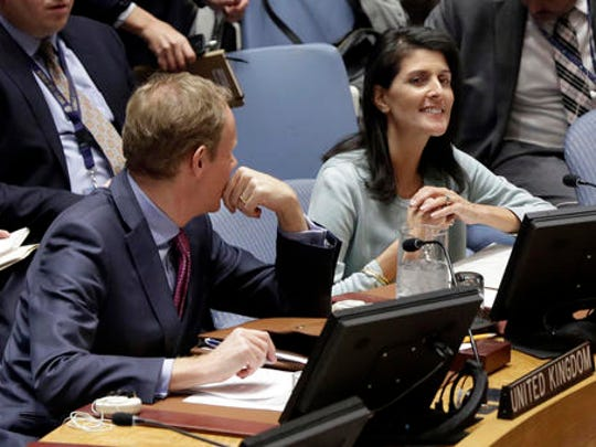 The new U.S. Ambassador to the U.N. Nikki Haley, right, and Britain's U.N. Ambassador Matthew Rycroft attend a Security Council meeting of the United Nations, Thursday, Feb. 2, 2017.