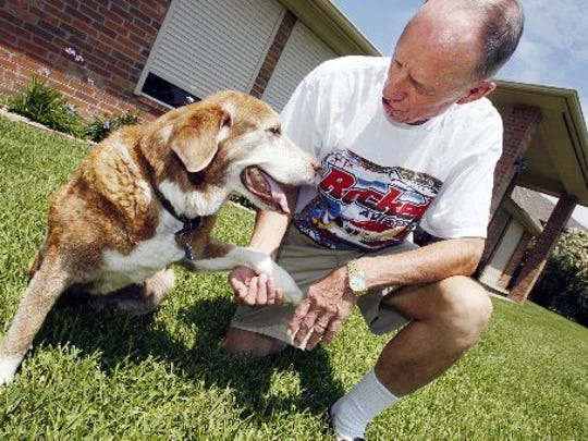 Gaylord Hoyt shakes hands with his dog, Amber Hoff Hoyt, at his home in 2010. Hoyt and his wife, Susan, donated $20,000 to the Gulf Coast Humane Society in honor of their dog in 2010.